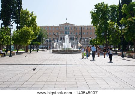 ATHENS-AUGUST 22: Syntagma Square with fountain and Parliament building on August 22 2014 in Athens Greece.
