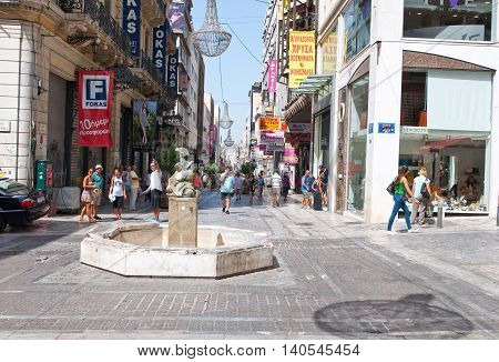 ATHENS-AUGUST 22: Shopping on Ermou Street with crowd of customers on August 22 2014 in Athens Greece. Ermou street is a main shopping street in Athens.