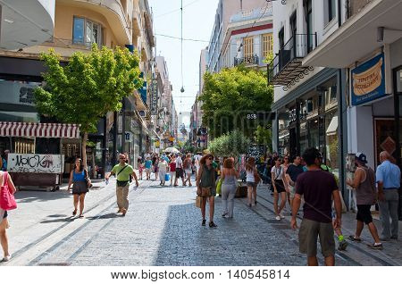 ATHENS-AUGUST 22: Shopping on Ermou Street in the morning on August 22 2014 in Athens Greece. Ermou street is a main shopping street in Athens.