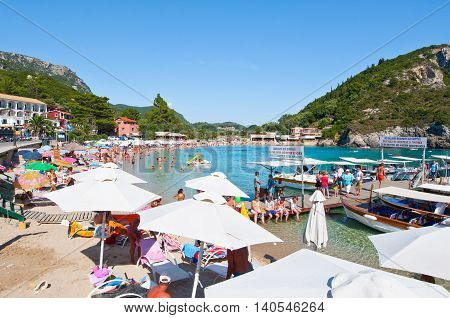 CORFU-AUGUST 26: View of the Palaiokastritsa beach holidaymakers sunbathing on the beach August 262014 on Corfu Greece. Palaiokastritsa is a village with famous beaches in the North West of Corfu.