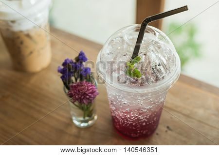 Strawberry soda on wood table in the cafe