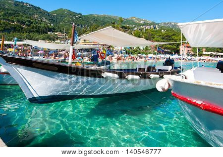 CORFU-AUGUST 26: Boats on the water on the Palaiokastritsa beach on August 262014 on the island of Corfu Greece. Palaiokastritsa is a village with famous beaches in the North West of Corfu.