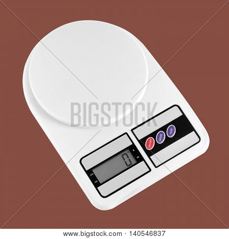Household appliances - Kitchen scales on a brown background. It is isolated the worker of paths is present.
