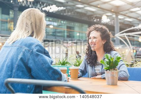 Two Women Having A Coffee Together In London