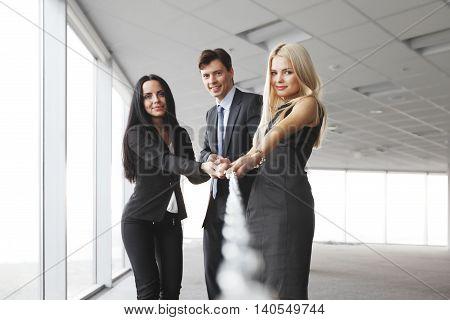 Businessmen pulling chain together teamwork togetherness concept