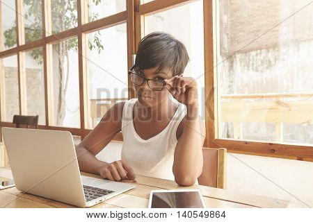 Charming Young Dark-skinned Female Freelancer With Pixie Hairstyle Using Laptop For Work At Home, Lo