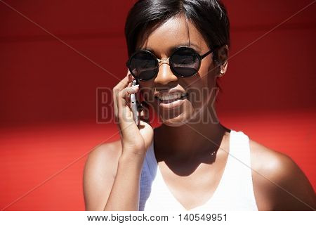 Successful Dark-skinned Female Choreographer Talking On Cell Phone With Dance Studio Owner About New