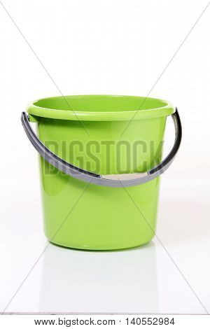 green pail on the white background