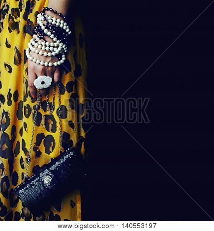 stylish clutch bag and accessories over black
