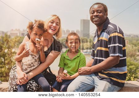 Happy International Family Enjoying While Children Eat Ice Cream Cornet