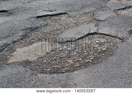 Damaged Asphalt Road