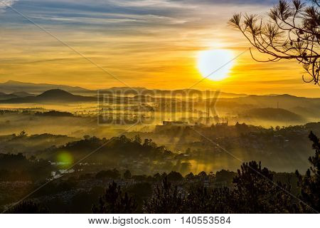Going to the high mountain to see the morning in Dalat. You will see the ray and the fog, they mix together to make a beautiful sunrise sightseeing