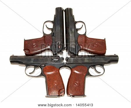 Four pistols on white background