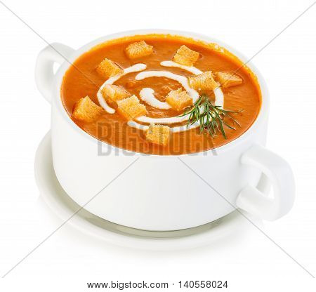 Delicious Pumpkin And Carrot Soup With Sour Cream And Croutons Close-up Isolated On A White Backgrou