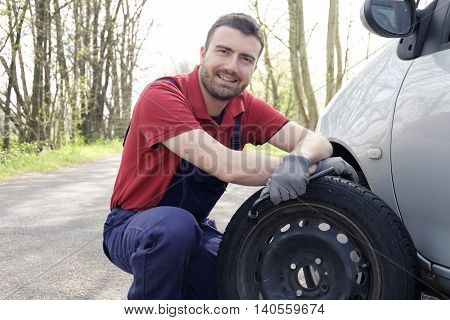 Man Fixing A Car Problem