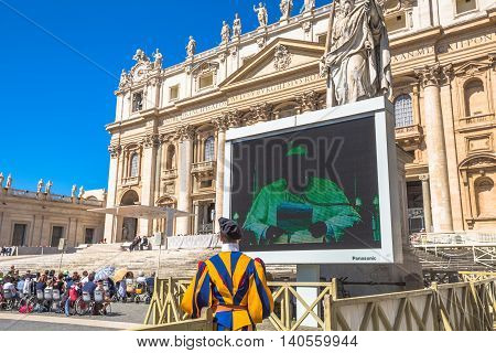 Rome, Italy - June 18, 2016: Pope Francesco speaking in Piazza San Pietro for jubilee event. On background, the Basilica di San Pietro or St. Peter's Basilica.