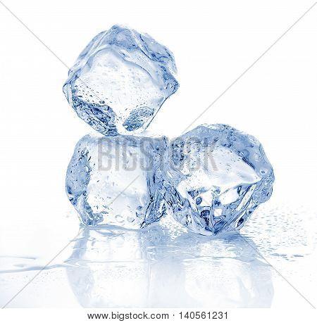 Three Melting Ice Cubes On White Background.