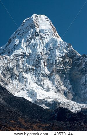 Summit of Ama Dablam from trekking route to Everest Pangboche Solukhumbu Nepal.