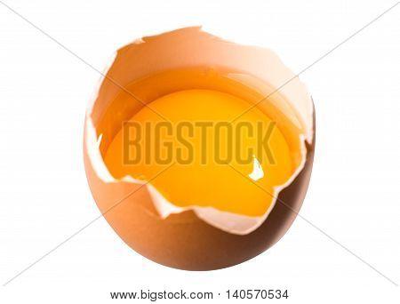 Yolk in broken egg isolated on white background