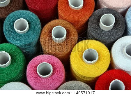 Colorful reels of threads background fashion color