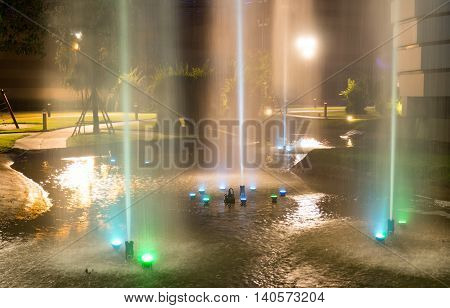 Fountains at night. Light blue and green.