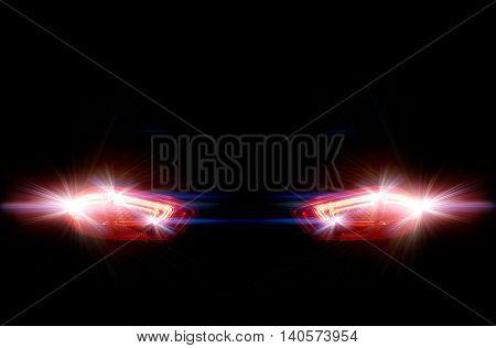 Rear car lights on a black background