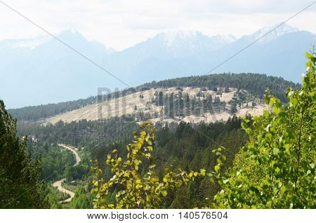 Top view on Holy Sand Mountain on a background of the East Sayan. Buryat Republic