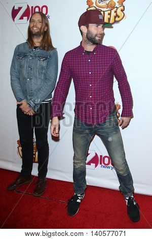 NEW YORK-DEC 12: Singer Adam Levine (R) and James Valentine of Maroon 5 attend Z100's Jingle Ball 2014 at Madison Square Garden on December 12, 2014 in New York City.