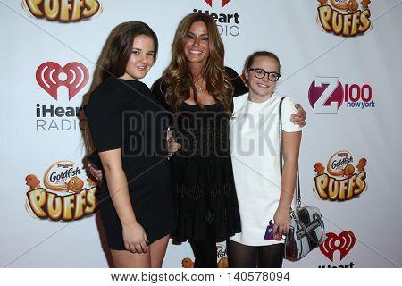 NEW YORK-DEC 12: Thadeus Ann Bensimon (L), Kelly Bensimon and Sea Louise Bensimon (R) attend Z100's Jingle Ball 2014 at Madison Square Garden on December 12, 2014 in New York City.