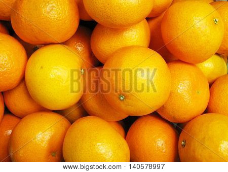 Mandarin orange fruit close up bright colorful background
