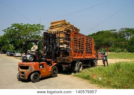The wreckages of the wood were loaded on the truck which was parking beside the street. March 22-2016 Chiang Mai Thailand.