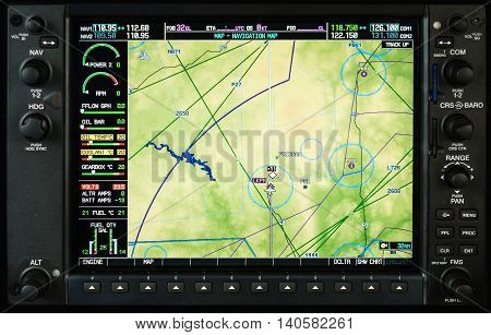 Airplane glass cockpit display G1000 with weather radar and engine gauges in small private airplane