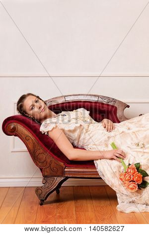 portrait of Victorian woman laying on couch