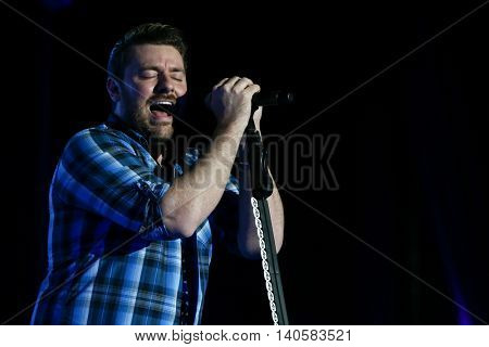 FARMINGVILLE, NY-JULY 3: Chris Young performs at the 6th Annual Fest at the Pennysaver Amphitheater on July 3, 2016 in Farmingville, New York.