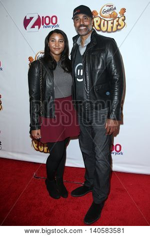 NEW YORK-DEC 12: Former professional basketball player Rick Fox (R) and daughter Sasha Fox attend Z100's Jingle Ball 2014 at Madison Square Garden on December 12, 2014 in New York City.