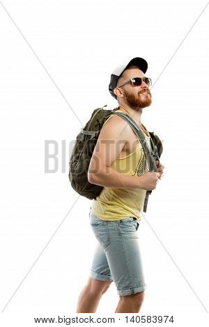 Backpacker with finger up walking in trip. Studio shot. Isolated