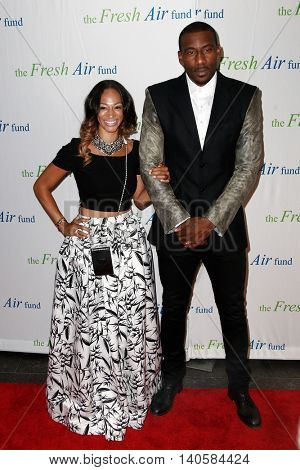 NEW YORK-MAY 29: NBA player Amar'e Stoudemire (R) and wife Alexis Stoudemire attend the Fresh Air Fund Spring Gala Salute at Pier Sixty at Chelsea Piers on May 29, 2014 in New York City.