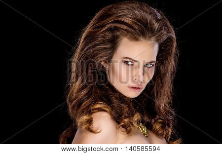 Portrait of attractive sexy model with hairstyle looking away with penetrating look.Isolate.Black background.