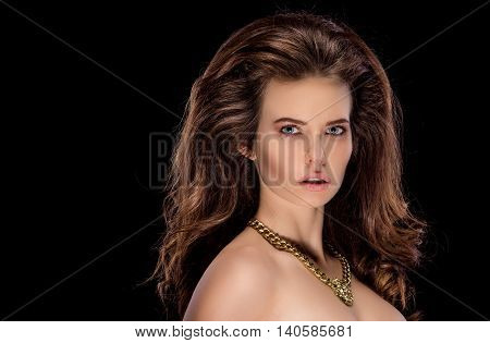 Portrait of attractive sexy model with hairstyle looking at camera with penetrating look.Isolate.Black background.
