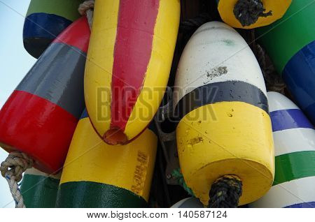 Brightly colored boating buoys bunched and hanging