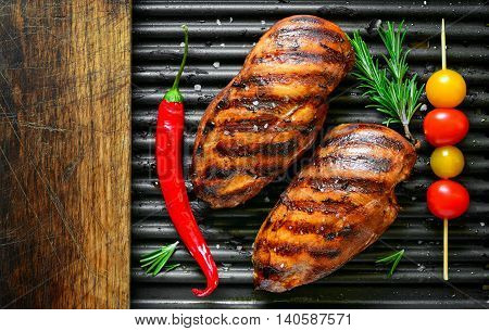 Spicy marinated grilled chicken breasts top view