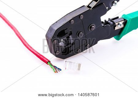 Network cable RJ-45 connector and crimping pliers on a white background