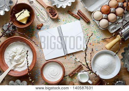 Easter baking background with baking ingredients and kitchen utencils