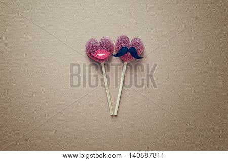 Funny decorated heart shaped jelly candies on a sticks, Valentine's day concept, stylized photo