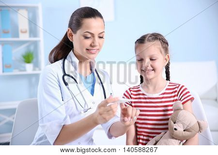 Cute girl visiting doctor