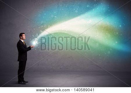 Caucasian businessman holding aurora borealis kind of stria of light