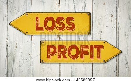 Direction Signs On A Wooden Wall - Loss Or Profit