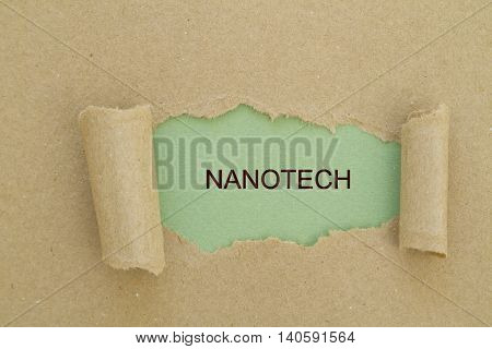 Nanotech word written under torn paper .