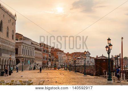 Doge's palace or Palazzo Ducale and Riva degli Schiavoni in sunrise. Venice. Italy.