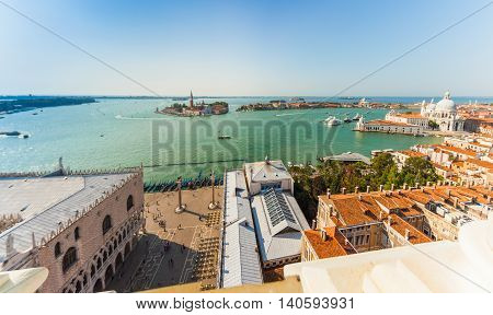 Panorama of Venice from the campanile tower of the Cathedral of St. Mark. View to the sea and the island of San Giorgio Maggiore. Aerial view. From above. Italy. Europe.